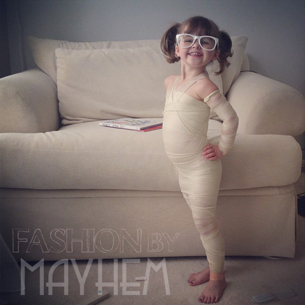On this day, we discovered an entire roll of athletic tape could become an amazing super hero outfit.